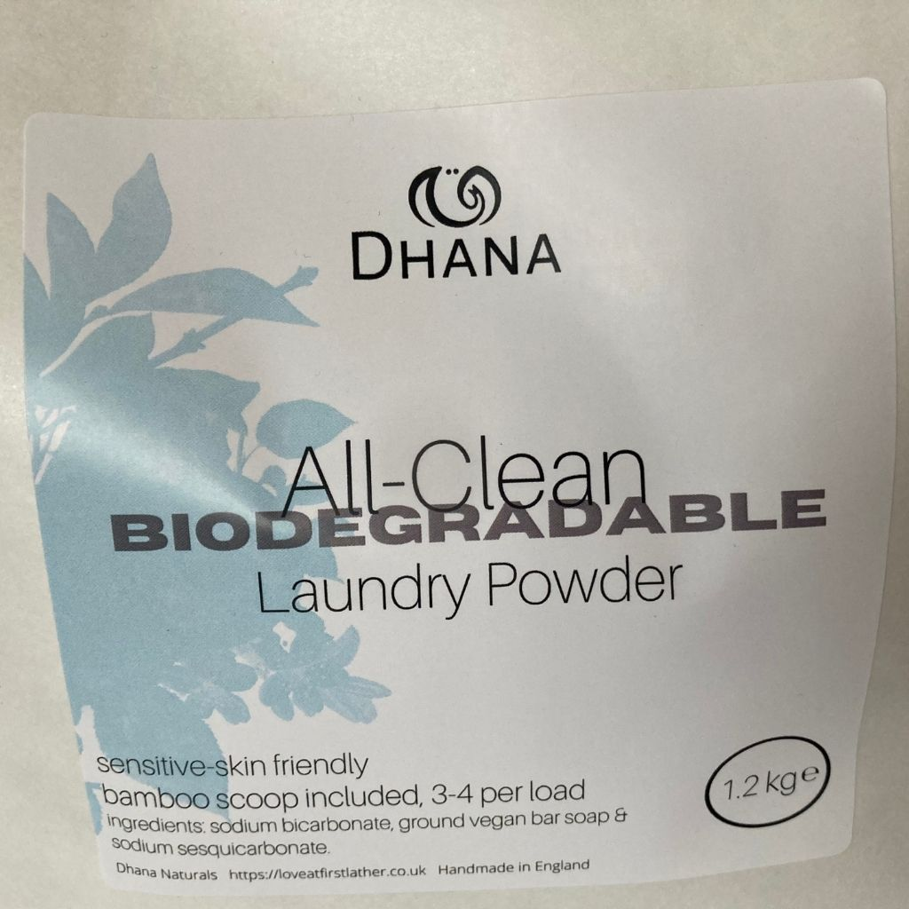 a white bag of laundry powder. Label reads All-clean Biodegradable Laundry Powder