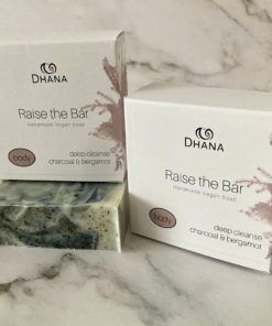 Raise the Bar Soap. Swirled bleu and white soap sits under a white box with its name on it.