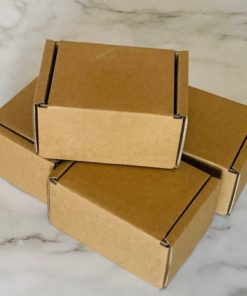 Tiny Kraft cardboard boxes on a marble backdrop