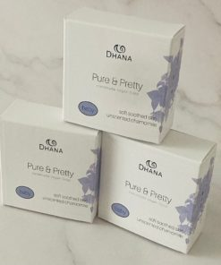three white and blue boxes stacked on a marble background. They read Pure & Pretty Unscented Baby Soap