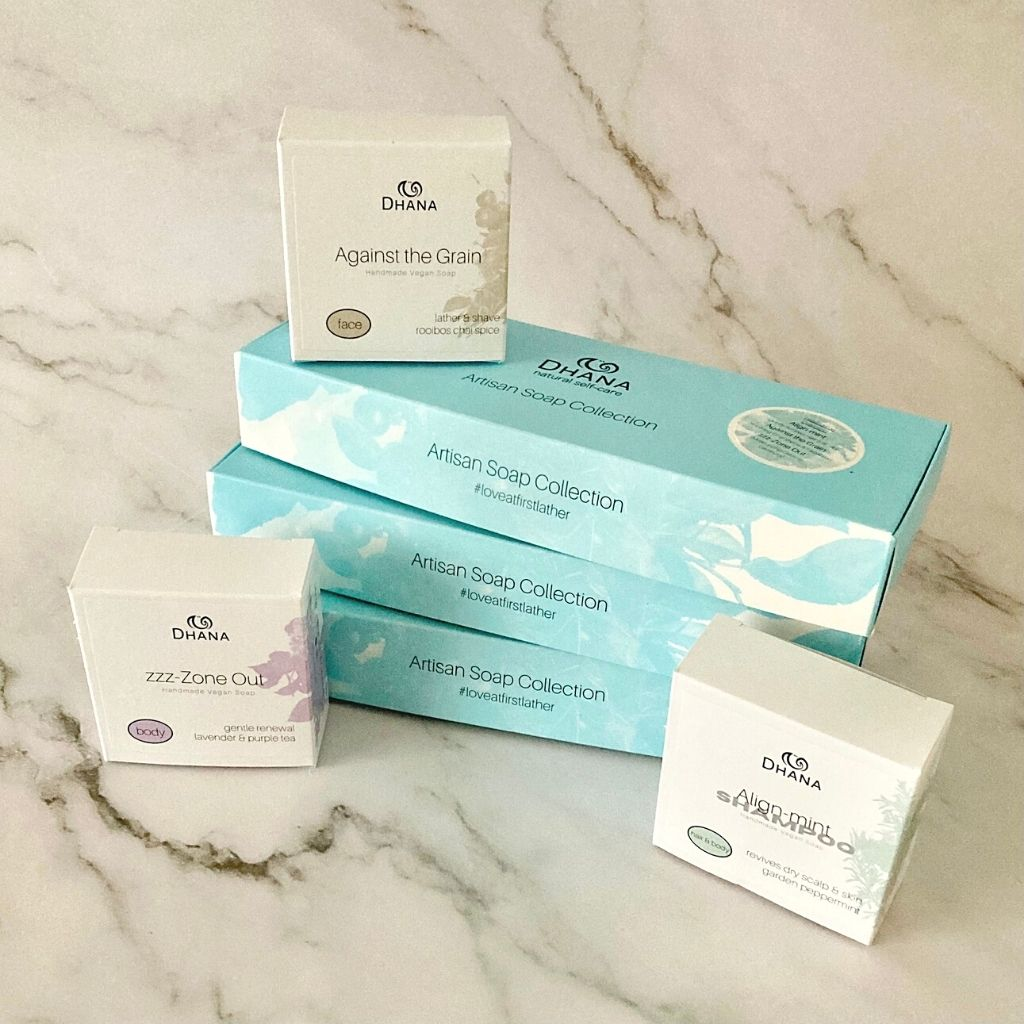 Head to Toe Collection - pictured are three long narrow turquoise boxes and three individual soap boxes that would fit inside. All on a marble backdrop