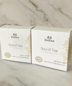 """two soap boxes white in colour with pale orange botanicals up the right. The box reads """"Soul of Tea"""" an English breakfast exfoliating facial bar."""