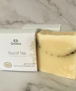 Soul of Tea white box beside bar of soap, cream in colour with exfoliants of tea in it