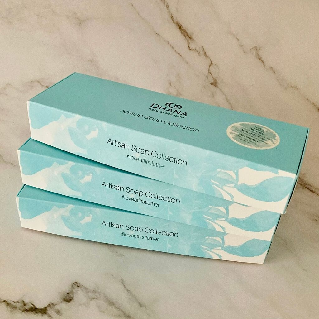turquoise gift boxes from dhana selfcare on marble backdrop