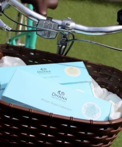 Turquoise soap collections in the basket of a green bike