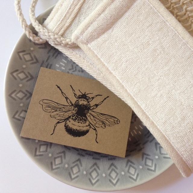 bee card on grey plate