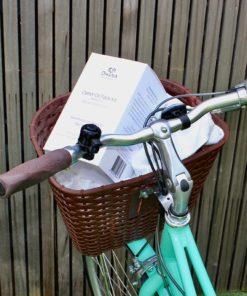 castor oil pack box in a bike basket