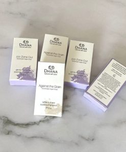 RTSB-s01 Tiny bars of Dhana Soap - brown and white and purple and white packaging. 5 soap boxes lined up on a marble background with one tipped up to see the label: Against the Grain Shaving Soap