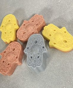 hamsa Soap collection. Image of 5 soaps yellow, terracotta and grey-purple