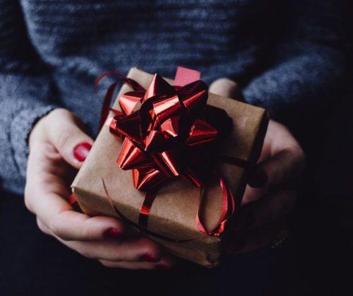 hands around a gift