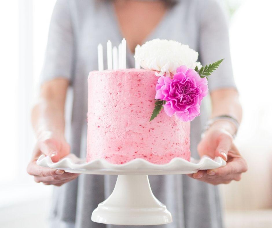 woman holding cake pink