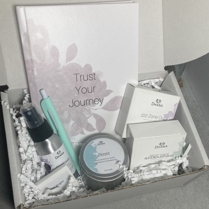 Hello Weekend Pamper Box with journal, 2 soap bars, spray, candle matches and pen nestled in to white shredded paper in a cardboard box